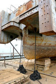 Feed old riverboat in dry dock on the stocks of the repair power — Stock Photo