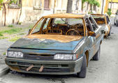 Blown car after civil strife thrown on the roadside. As a result — Stock Photo