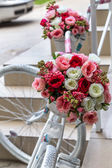 Colorful flowers in a bouquet of roses as decoration an old bicy — Stock Photo