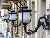 Vintage bronze white street lights in a row on the wall of the h — Stock Photo