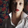 The crying beautiful young woman in a man's shirt — Stock Photo