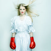 Beautiful woman in white dress with boxing gloves. Boxer bride — Stock Photo