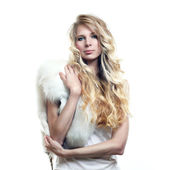Photo of beautiful woman with magnificent hair in fur — Stock Photo