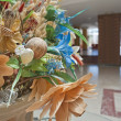Artificial flower display in a hotel lobby - Stock Photo