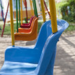 Closeup of swings in a playground — Stock fotografie