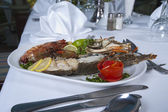 Seafood meal in an a la carte restaurant — Stock Photo