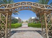 Wooden frame in a hotel garden — Stock Photo