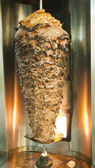 Large beef kebab on a spit roast — 图库照片