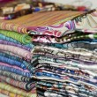 Fabrics at a market stall — Foto Stock