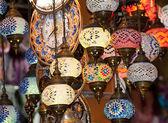 Ornate glass lights at market stall — Stock Photo