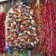 Dried vegetables hanging at a market — Stock fotografie