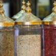 Peppercorns in ornate jars — Stock Photo