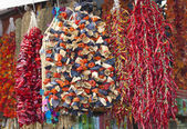 Dried vegetables hanging at a market — Stock Photo