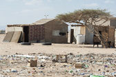 Traditional house in a poor african town — Stock Photo