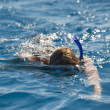Person snorkeling intropical lagoon — Stockfoto #15828519