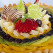 Fresh fruit on a sponge cake — 图库照片