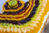 Fresh fruit on a sponge cake — Stock Photo