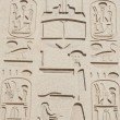 Egyptian hieroglyphic carvings on wall — Lizenzfreies Foto