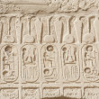 Egyptian hieroglyphic carvings on wall — Stock Photo #19287669