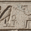 Egyptian hieroglyphic carvings on wall — Stok fotoğraf