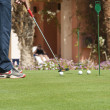 Stock Photo: Golfer practising putting