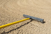 Rake in a bunker — Stock Photo