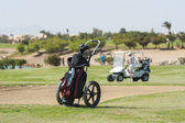 Golf caddy trolley on fairway — Stock Photo