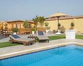 Luxury villa swimming pool — Stock Photo