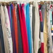Clothes hanging on a rail — Stockfoto