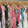 Stock Photo: Clothes hanging on a rail