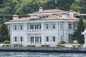 Luxury water front villa on river — Stock Photo