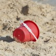 Childs bucket on a tropical beach — Stock Photo