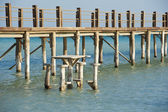 Wooden jetty on a tropical island — Stock Photo