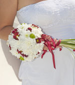 Bride holding a flower posy — Stock Photo