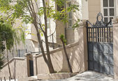 Exterior wall of an apartment building with gate — Stock Photo