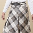 Closeup of womens skirt on biege background — Stock Photo