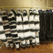 Stock Photo: Fur coats hanging on rail