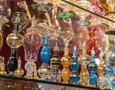 Ornate perfume bottles on a shelf — Stock Photo