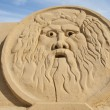 Sand sculpture of greek god zeus — Stock Photo #38349337