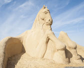 Sand sculpture of large horse — Stock Photo