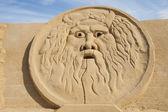 Sand sculpture of greek god zeus — Stock Photo