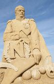 Sand sculpture of emperor napoleon against blue sky — Stock Photo