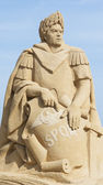 Sand sculpture of Julius Caesar against blue sky — Stock Photo