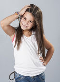 Young latino girl posing in studio — Stok fotoğraf