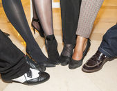 Collection of footwear on peoples feet — Foto Stock