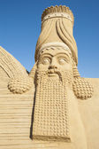 Large sand sculpture of Lamassu deity — Stok fotoğraf