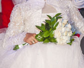 Bride at a wedding holding a bouquet — Photo
