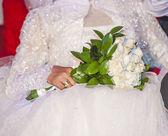 Bride at a wedding holding a bouquet — Zdjęcie stockowe