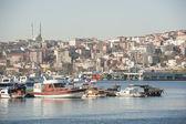Urban cityscape on large river with marina — Stock Photo