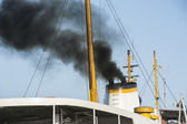 Exhaust smoke from a ship smoke stack — Stock Photo